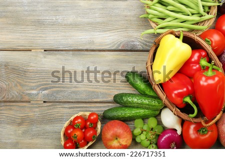 Summer frame with fresh organic vegetables and fruits on wooden background - stock photo
