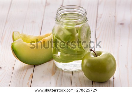 Summer fresh fruit Flavored infused water mix of apple and melon - stock photo