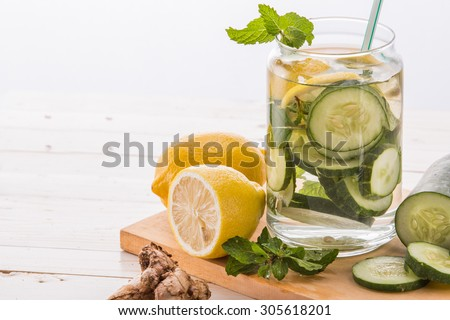 Summer fresh fruit Flavored infused water mix of cucumber and lemon - stock photo