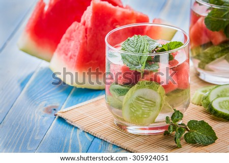 Summer fresh fruit Flavored infused water mix of cucumber, watermelon, and mint leaf - stock photo
