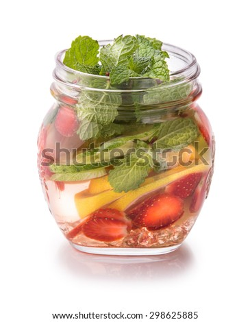 Summer fresh fruit Flavored infused water mix of lime, cucumber, strawberry and mint isolated over white background