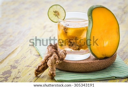 Summer fresh fruit Flavored infused water mix of mango and ginger - stock photo