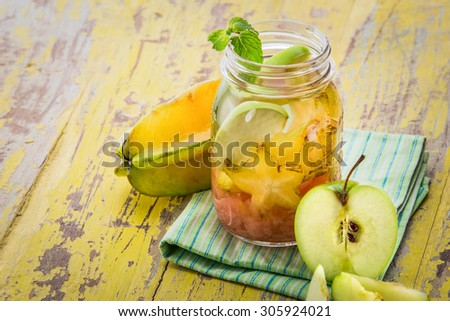 Summer fresh fruit Flavored infused water mix of starfruit, grapefruit, and apple - stock photo