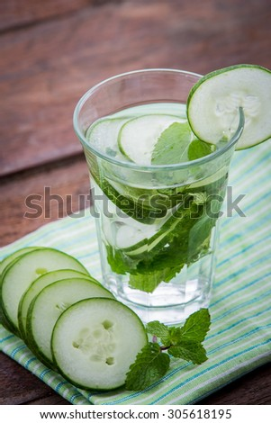 Summer fresh fruit Flavored infused water of sliced cucumber - stock photo