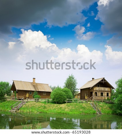 Summer from rural landscape. Wooden house near lake - stock photo