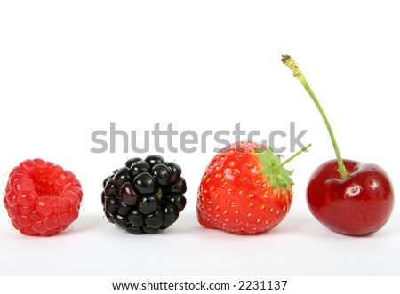 Summer fruit salad ingredients, strawberry, raspberry, cherry and blackberry, macro close up on white with copy space - stock photo