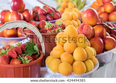 Summer fruits-  nectarines, apricots and strawberry with leaves for sale at city market.  Baku. Azerbaijan