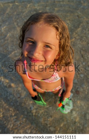 Summer fun, beach - young snorkel girl in the sea, active child concept - stock photo