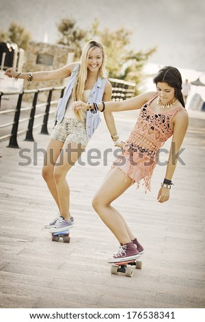 summer fun healthy girls with skateboards.  - stock photo