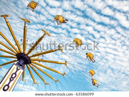 Summer Fun in Carnival Ride in the Sky - stock photo