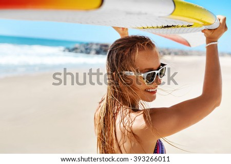 Summer Fun On Holidays Travel Vacation. Surfing. Sexy Beautiful Surfer Girl In Bikini With Surfboard. Healthy Lifestyle. Extreme Water Sports. Summertime Leisure Activity. Hobby. Wellness Concept - stock photo