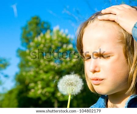 Summer fun, sweet little girl blowing dandelion on the meadow - stock photo