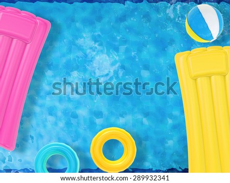 summer fun with inflatable toys floating on pool top view - stock photo