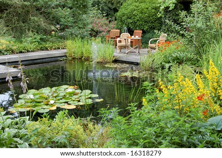 Summer Garden With A Pond And Garden Seats
