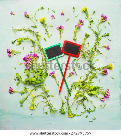 Summer gardening with blooming plant and two wooden sign on rustic background, top view, copy space - stock photo