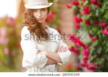 Summer girl in garden - stock photo