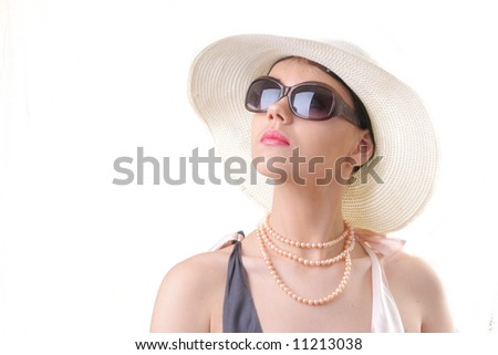 summer girl in sun glasses and white hat pretty young lady  looking to the photographer
