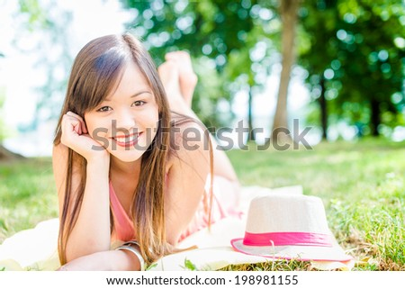 Summer girl portrait. Asian woman smiling happy. - stock photo