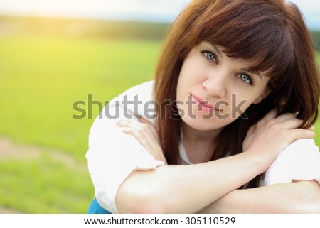 Summer girl portrait. Russian woman smiling happy on sunny summer or spring day outside. young woman outdoors.