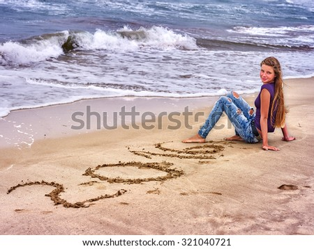 Summer girl sea.  Woman written in sand  2016 near ocean with waves. - stock photo