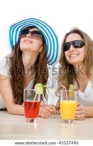 Summer girls enjoying a cocktail isolated over a white background - stock photo