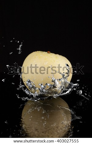 Summer green apple and water splash