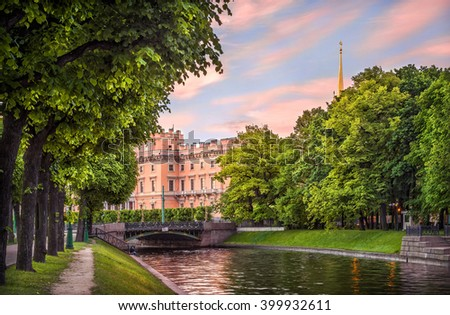 Summer greens at the Mikhailovsky Castle in the early morning and pink colors in the sky
