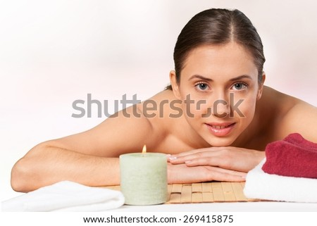 Summer. Half face of sexy brunette girl enjoying day spa on massage table outdoors, exotic beach resort, palm trees, well being and pleasure concept - stock photo