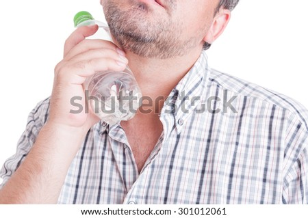 Summer heat or heatwave concept with man holding a bottle of cold water isolated on white - stock photo