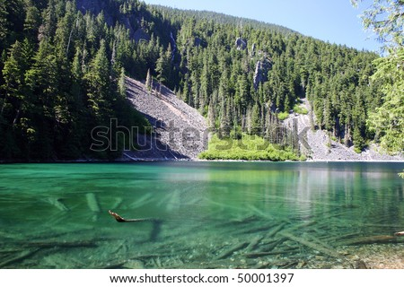 Summer hiking view in green drop lake. - stock photo
