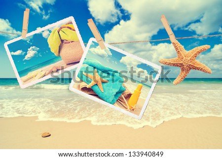 Summer holiday items against a beach scene with vintage effect - stock photo