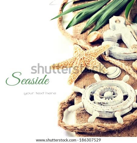 Summer holiday setting with seastar - stock photo