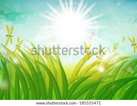 Summer holiday. Spring grass in sun light and blue sky on paper texture background. - stock photo