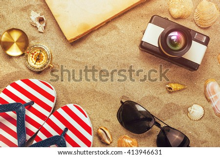 Summer holiday vacation accessories on beach sand, summertime lifestyle objects in flat lay top view arrangement. - stock photo