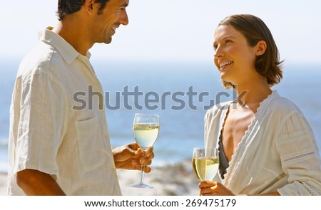summer holidays and dating concept - couple drinking champagne - stock photo