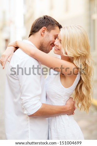 summer holidays and dating concept - couple in the city - stock photo