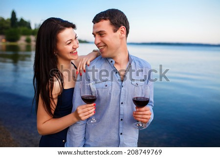 summer holidays and dating concept - smiling couple drinking wine - stock photo