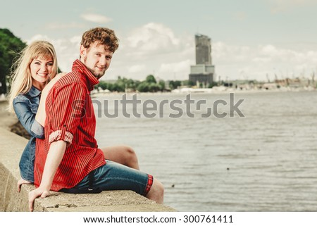 Summer holidays and happiness concept. Loving couple spending leisure time together at seaside - stock photo