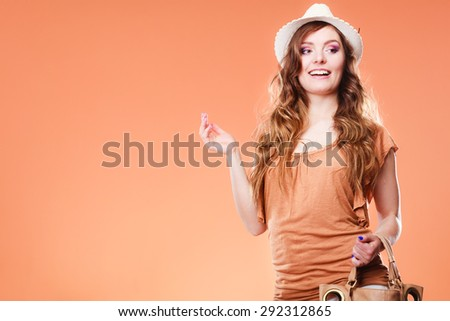 Summer holidays and vacation. Girl in fashionable clothes straw hat. Portrait of attractive woman tourist on brown