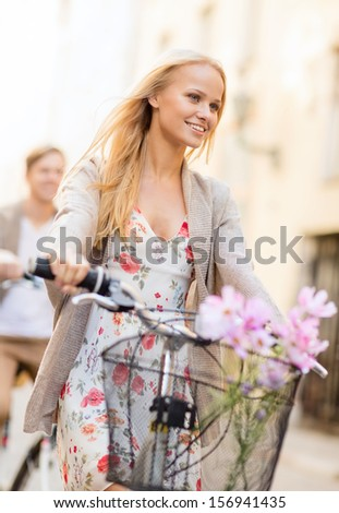 summer holidays, bikes, love, relationship and dating concept - couple with bicycles in the city - stock photo
