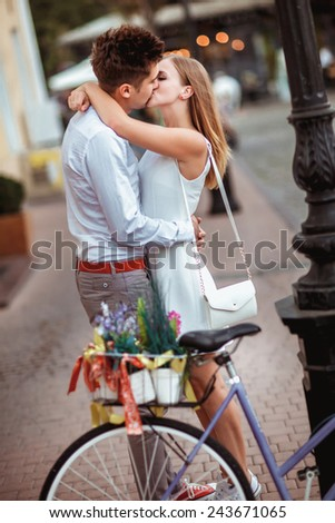 Summer holidays, bikes, love, wedding- couple with bicycles in the city. - stock photo