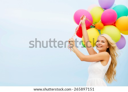 summer holidays, celebration and lifestyle concept - beautiful woman with colorful balloons outside - stock photo