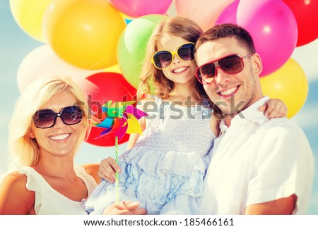 summer holidays, celebration, children and people concept - family with colorful balloons - stock photo