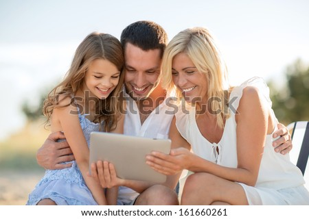 summer holidays, children and people concept - happy family with tablet pc taking picture - stock photo