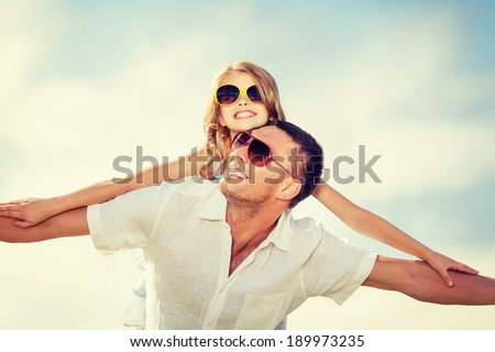 summer holidays, children and people concept - happy father and child in sunglasses over blue sky - stock photo