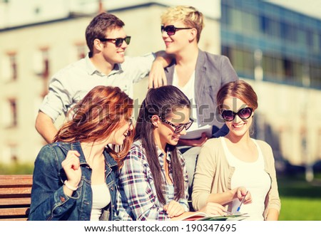 summer holidays, education, campus and teenage concept - group of students or teenagers with books, notebooks, files and folders - stock photo