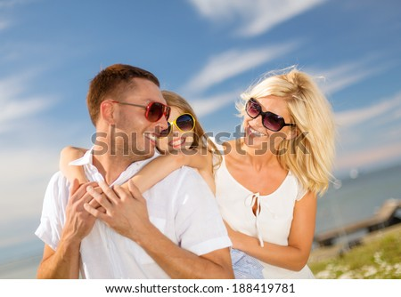 summer holidays, family, children and people concept - happy family in sunglasses having fun outdoors
