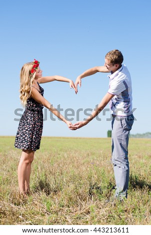 Summer holidays, love, romance and people concept. Happy smiling young hippie couple hugging outdoors from back - stock photo