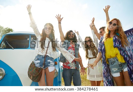 summer holidays, road trip, vacation, travel and people concept - smiling young hippie friends having fun over minivan car - stock photo