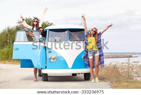 summer holidays, road trip, vacation, travel and people concept - smiling young hippie friends over minivan car - stock photo